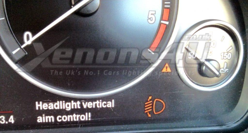 BMW Head light vertical aim control